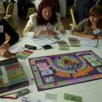 Игра Cashflow 101 + 202, люди играют в российскую версию игры Роберта Кийосаки Денежный поток 101 и 202